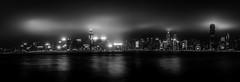 Hong Kong Skyline in Black & White (Gerald Ow) Tags: hongkong tsimshatsui black white bw long exposure panorma geraldow canon eos 5dmkii 5dmk2 ef 1740mm f4l night photography monochrome tst