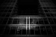 Steel of light (Alessandro Vastalegna) Tags: monochrome canon700d efs1755mm london canarywharf glass reflection steel metal blackandwhite architecture geometric lines financial district contrast tones darkness 2016 summer naturallight overcast marumi values building obscure power
