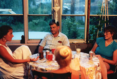Coffee and beer at the back porch table. My sister at left seems to be explaining something to my dad while my wife looks on. The back of Mom's hair bun swirls in the center of the view. Milford Connecticut. July 1986 (wavz13) Tags: budweiser budlight oldphotographs oldphotos 1980sphotographs 1980sphotos oldphotography 1980sphotography vintagesnapshots oldsnapshots vintagephotographs vintagephotos vintagephotography filmphotos filmphotography vintagemilford oldmilford 1980smilford vintagewoodmont oldwoodmont 1980swoodmont connecticutphotographs connecticutphotos oldconnecticutphotography oldconnecticutphotos oldconnecticut vintageconnecticut connecticutphotography vintagenewengland oldnewengland 1980snewengland vintagenewenglandphotography oldnewenglandphotography vintagenewenglandphotos oldnewenglandphotos vintage35mm old35mm vintagekodacolor vintageteengirls vintageteenagegirls female longhair oldclothes vintageclothes oldclothing vintageclothing family familyphotos familyphotography oldfamilyphotos oldfamilyphotography vintagefamilyphotos vintagefamilyphotography oldbeercans vintagebeercans