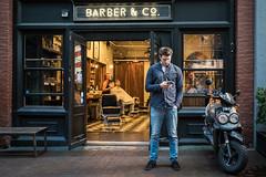 On Abbott St (johnjackson808) Tags: abbottst fujifilmxt1 gastown vancouver barber barbershop cellphone motorcycle people streetphotography