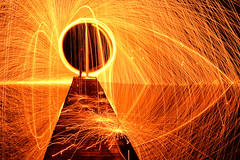 Me in the orb of fire (PentlandPirate of the North) Tags: spinning wire wool sparks reflection lake jetty