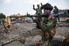 """The World's Youngest Country Is 'on the Brink' of Genocide, Says a UNHCR Report. """"The stage is being set for a repeat of what happened in Rwanda."""" (karo4greatness) Tags: topshots horizontal africa soldier rocketlauncher shouting bust openmouthed firingposition trench malakal southsudan"""