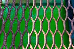 Rusting metal walkway over water (yourewelcomephotography) Tags: bridge usa abstract macro green art modern rust explorer vivid iowa explore lookdown walkway quarry linescurves exploreeverything