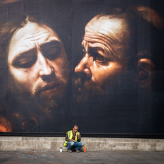 Betrayal (Ruth Flickr) Tags: caravaggio england faction london trafalgarsquare uk alone city man painting street london5137 kiss jesus judas traitor