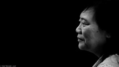 Family Dynamics. (Neil. Moralee) Tags: neilmoralee woman chinese asian mature violence violent face close portrait profile left lady candid black white bw blackandwhite mono monochrome people blackbackground neil moralee nikon d7100 alone wide rites republic law