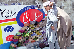 Muslim cap street shop in Gilgit, Pakistan (inchiki tour) Tags: travel photo film pakistan     pakistani  pamir karakoram   gilgit  people street road bazaar market