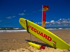Life Savers Surf Board On The Beach (k009034) Tags: 500px yellow australia caloundra copy space pacific queensland tranquil scene beach clouds flag lifeguard nature no people ocean red sand sea sky support surf board travel destinations waves wind teamcanon