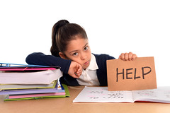 sweet little girl bored under stress asking for help in hate school concept (mommymundoxyz) Tags: school stress student education homework child girl young female exam learn reading desk schoolgirl tired studying kid sadness frustration sad face boredom bored depression little white cute exhausted pretty table isolated textbook unhappy upset 67 learning difficult fatigue frustrated pupil expression hispanic stressed struggle latina latin spanish mexican backtoschool