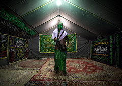 Man inside a tent and dressed as imam hussein during ashura commemoration, Lorestan province, Khorramabad, Iran (Eric Lafforgue) Tags: 1people adult adultsonly ashura calligraphy carpet ceremony clothing colorimage commemoration drama fulllength historicalreenactment horizontal hossein imamhussein indoors iran iranian islam khorramabad lookingatcamera man martyrdom memorialevent middleeast mourning muharram muslim onemanonly oneperson periodcostume photography play portrait religion religiouscelebration shia shiism shiite tazieh tent theatre unrecognizableperson lorestanprovince ir
