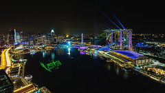 MBS Laser Show (Arief Rasa) Tags: night marina park autumn travel business rhapsody attraction skyline light asia tourist reflection architecture color colorful panorama bay tourism hotel fountain cityscape autunm tropical mbs waterfront urban landmark show singapore luxury full moon building modern sands mid city scene water landscape gardens
