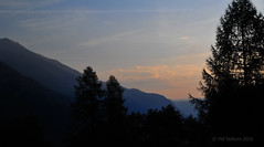 Morning light (Vee living life to the full) Tags: italy leger travel touring holiday nikond300 landscape rock towers mountain heathaze view road sky cloud blue water morning light