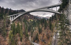 Salginatobel Bridge, an engineering wonder from 1930 (PeterThoeny) Tags: switzerland alps graubünden grison schuders salgina salginatobelbridge salginatobel bridge reinforcedconcretearchbridge concretebridge architecture hdr 1xp raw nex6 selp1650 photomatix day cloudy clouds qualityhdr qualityhdrphotography outdoor arch swissalps fav200