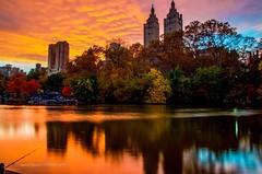 Sunset at Central Park, New York City. (mitzgami) Tags: sanremobuilding centralparkwest clouds sky skyline foliage fall autumn landscape longexposure d7000 nikonphotography newyorkcity inexplore flickr thelake centralpark sunset