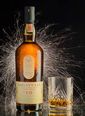 Celebrate with Lagavulin (johnarobb) Tags: scotch whisky whiskey alchohol sparks long exposure bottle crystal lagavulin