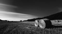 Hay bales (jarnasen) Tags: longexposure sky blackandwhite bw nature monochrome field clouds landscape mono daylight fuji sweden outdoor tripod extreme seasonal smooth wideangle le sverige hay bales fujinon landskap movingclouds ndfilter naturfoto firecrest sturefors xt1 nd16 formatthitech xf1024mmf4