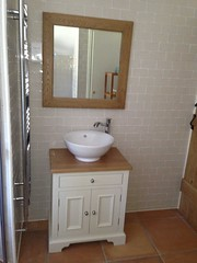 Cream tiles with free standing sink