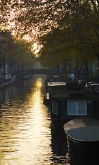 Sunset on the Canals (Patrick Dirden) Tags: autumn light sunset holland reflection fall water netherlands amsterdam boat canal europe dusk houseboat canals nl centrum jordaan bloemgracht amsterdamcentrum