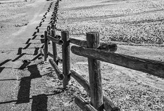 Parititions (MarcCooper_1950) Tags: california park blue sky blackandwhite panorama brown mountains blancoynegro geometric monochrome landscape outside outdoors death wooden nikon shadows desert patterns fences national valley designs deathvalley lightroom harmonyboraxworks 5000views 100faves 6000views 200faves d810