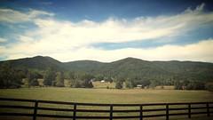 Country Roads (AluminumDryad) Tags: landscape outdoors mountain meadows fenceline clouds sunnyday backroads albemarlecounty virginia trees outbuildings farm