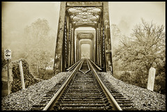 Into the Mist (Back Road Photography (Kevin W. Jerrell)) Tags: railroad trestles backroadphotography fog nikond60 silverefexpro2 scottcounty virginia clinchriver clinchport sepia perspective summer bridge tracks