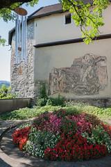 (Maya Lucchitta) Tags: austria basilicarankweil ourdearladymaryvisitation pilgrimagechurch rankweil unsereliebefraumariäheimsuchung basilica church flowers mosaic windchimes
