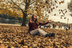 Autumn games (mystero233) Tags: autumn game playing park girl leaves leaf fun yellow tree hydepark london outdoor winteriscomming fall