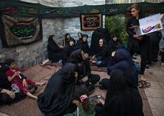 Iranian shiite women share tea and cakes in a private house for nazri during chehel manbar festival on tasua to commemorate the martyrdom anniversary of hussein, Lorestan province, Khorramabad, Iran (Eric Lafforgue) Tags: 9people ashura celebration ceremony chador chehelmanbar children colorimage commemoration covered groupofpeople hidden horizontal husayn hussain imamhussein iran islam khorramabad memorialevent middleeast mourner mourners mourning muharram muslim mystery outdoors persia persian religion religious ritual script shia shiism shiite tasoua tasua togetherness tradition veil veiled woman women lorestanprovince ir