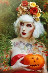 It is Halloween. (Laura Jane Harding) Tags: flowers autumn portrait orange halloween nature beautiful beauty tattoo pumpkin model conceptual