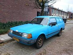 Mazda 323 1.3 3d Van 1983 (38-RXF-8) (MilanWH) Tags: 3d 1983 van mazda 13 zwolle 323 panelvan 38rxf8 sidecode7