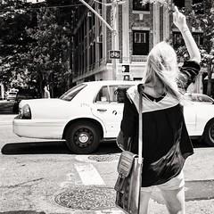 hailing a cab (Gerard Koopen) Tags: street nyc newyorkcity bw woman usa newyork 35mm nikon candid cab taxi unitedstatesofamerica streetphotography unionsquare d800 2014 straatfotografie verenigdestaten zeissdistagon gerardkoopen