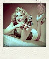 lady with cine camera (Leo Reynolds) Tags: xleol30x poladroid polaroid faux fauxpolaroid fake fakepolaroid phoney phoneypolaroid people nottakenbyme camera photographer groupeffectedcameras