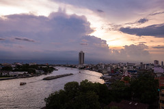 Bangkok at Sunset (virtualwayfarer) Tags: thai thailand visitthailand asia southeastasia bangkok capital thaicapital sunset cloud clouds skies dramatic weather weatherformation stormclouds river water ferry ferries barge skyscraper setting settingsun canals travel traveling travelphotography thingstosee visittothailand canon canon6d travelphotographer travelinspiration lifestyleinspiration