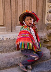 singing boy (sussexscorpio) Tags: colours colourful hat child boy peru southamerica canon canon60d sitting singing outdoors outside people costume portrait