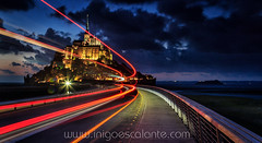Mont Saint Michel at night (Iigo Escalante) Tags: sky sea sunset water travel night light clouds architecture lights bridge france long exposure bus abbey nocturna normandy normandie trafic mont saint michel manche le montsaintmichel lower