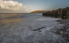 Ghostly shore (Through-my-eyes.) Tags: porlockweir seascape water sea ocean somerset tide tidal coastal coast wooden wood clouds cloud longexposure landscape pebbles outside outdoors porlock beach springtide southwest outdoor groyne groynes
