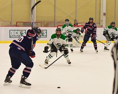 Taking a peek... (R.A. Killmer) Tags: peeking goalie sru skate skill save stick ice hockey green white slapshot puck net