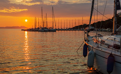 The Setting Sun - The Harbour - Sivota - Greece (Canon EOS 7D & EF 35mm f2 Prime) (1 of 1) (markdbaynham) Tags: greece greek grecia greka hellas hellenic sivota sunset sun clouds colour harbour boats view landscape canon canonites canonite eos 7d apsc dslr ef 35mm f2 prime