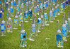 For every unknown soldier a flower bottle (Antropoturista) Tags: belgium lommel cemetery german installation bottles blue flowers unknownsoldiers red