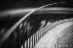 Vrtigo (Carlos Torija) Tags: abstract abstracto carlostorija olympus epm2 blackandwhite bw monochrome monocromtico blancoynegro barandilla rail railing dark black vertigo vrtigo bn water agua reflejos reflections estanque pond alcaldehenares alcal espaa spain motion movimiento mareo blury desenfoque