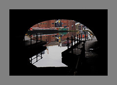 Birmingham Canal (Paul Acarnley) Tags: birmingham canal tunnel light water reflection boat colour path fence