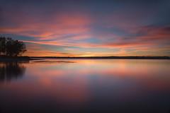 Smooth Morning (mclcbooks) Tags: dawn sunrise daybreak morning clouds light sky lake trees silhouettes reflections chatfieldstatepark lakechatfield colorado longexposure le