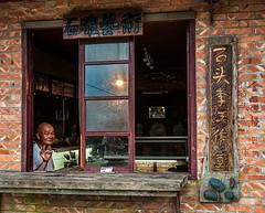 Cafe in Taiwan (Wanda Amos@Old Bar) Tags: street man taiwan shopkeeper wandaamos
