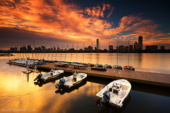 Cloudy Golden Sunrise over Boston Skyline and Charles River, MIT Sailing Pavilion with Dock from Cambridge Massachusetts USA (Greg DuBois - Sponsored by LEE Filters) Tags: city longexposure morning urban orange usa seascape water yellow boston skyline architecture america sunrise buildings reflections river dark boats gold golden early dock colorful downtown cityscape waterfront skyscrapers unitedstates mit massachusetts charlesriver newengland wideangle financialdistrict waterblur northeast backbay highrises hancocktower eastcoast waterreflection bostonskyline waterscape skyfire tallbuildings prudentialtower urbanriver ndfilters fierysky dramaticlight cloudmovement newenglandcoast liquidgold neutraldensity goldensunrise bostonarchitecture mitsailingpavilion bostonphotographer leefilters bostonsunrise backbayboston bostonphotography canon6d graduatedfilters gregdubois littlestopper gregduboisphotography gregduboisboston backbaybostonskyline charlesriversunrise bostonskylinesunrise