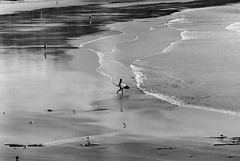 Surf (rostislavdidenko) Tags: ocean road sea reflection water lens grey coast sand surf waves alone board great australia melbourne 11 surfing victoria iso 200 vic lonely zenit jupiter ilford wetsuit surfs 37a