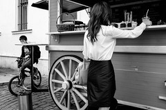 Coffee time (Pierre Pichot) Tags: street city urban blackandwhite woman white playing black streets coffee bicycle shop blackwhite back kid fuji bra streetphotography skirt romania fujifilm nutella ro classy cluj napoca clujnapoca x100t județulcluj
