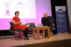 Rosie Goldsmiths, chair of the evening, welcome Slovenian writer Evald Flisar on the stage.