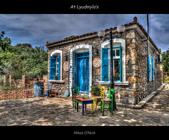 At Lyudmyla's (Nikos O'Nick) Tags: old sky house building art abandoned shop for nikon village chairs sale aegean hellas nikos greece colourful nikkor hdr manfrotto relic  limnos lemnos  1835mm  pedino palaio  lyudmyla onick  055xprob d300s   aigaion  498rc2 kotanidis