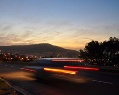Racing to Signal Hill (DJ Cockburn) Tags: africa road sunset car night southafrica lights twilight capetown motionblur signalhill westerncape n2 nelsonmandelaboulevard