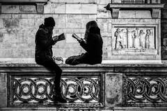 Doing homework (MacCabri) Tags: blackandwhite monochrome street streetphotography streetcapture hungary budapest reading girls books sitting church szent istvan bazilika