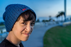 Teenage boy portrait downtown.jpg (AdamCottonPhotography) Tags: artsy downtown landscape portrait family adam cotton blue pensacola photographer teenage boy beenie sony mirrorless rotolightneo zeiss